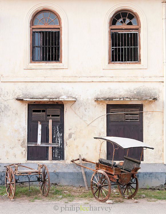 A rickshaw leaning against an old colonial building in Galle Sri Lanka
