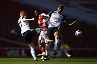 Football - 2020 /2021 Premier League - Arsenal v Fulham - Emirate Stadium<br /> <br /> Fulham's Harrison Reed and Mario Lemina battles with Arsenal's Eddie Nketiah.<br /> <br /> COLORSPORT