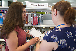 Out reach workers with talking books aids for visually impaired people