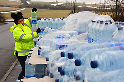 © Licensed to London News Pictures.05/03/2018<br /> Lenham, UK.<br /> South East Water staff work hard to hand out 3 bottles of water per house hold.<br /> Bottled water delivered to Northdown Close in Lenham.<br /> 7000 homes in Lenham and Ashford in Kent without water as thawing pipes burst after the big freeze.<br /> Photo credit: Grant Falvey/LNP