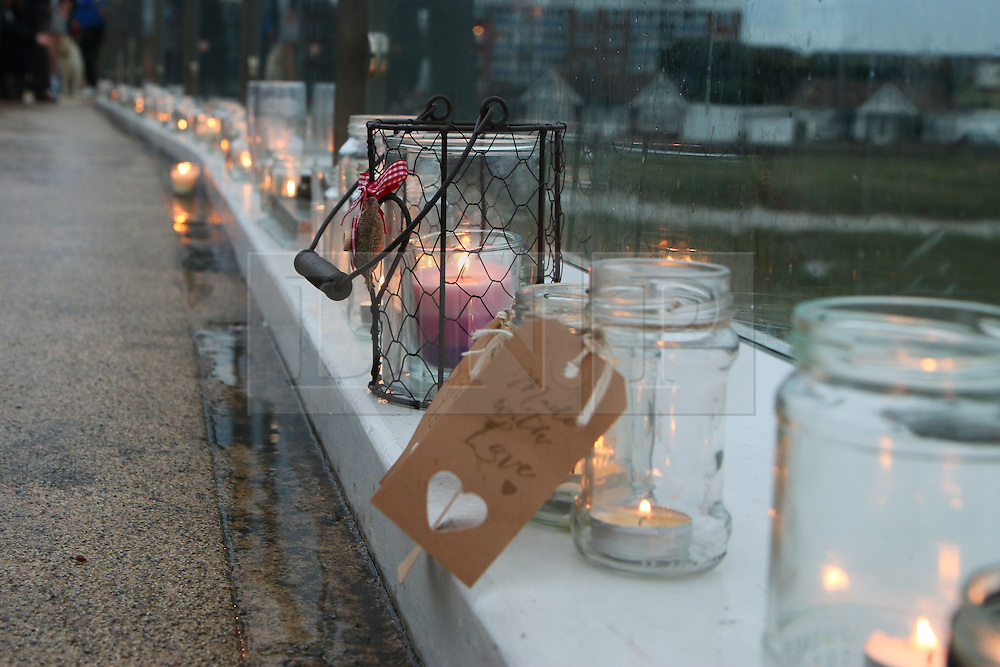 © Licensed to London News Pictures. 29/08/2015. Shoreham, UK. Thousands of people turn out at the Adur Ferry Bridge in Shoreham to light a candle at the Bridge of Light event and remember those who died in the Shoreham Air Crash last Saturday August 22nd. 11 people have been confirmed dead. Today August 29th 2015. Photo credit : Hugo Michiels/LNP