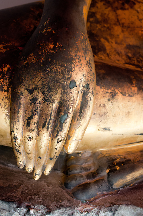 The golden hand of a Buddha statue in Wat Po in Bangkok, Thailand