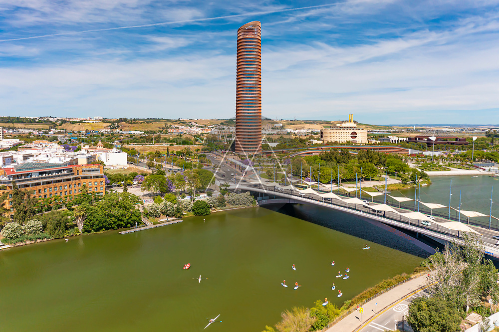 Aerial view of people with canoe on the river with the Torre de Seville building in the background in Seville, Andalusia, Spain.