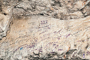 Israel, Jerusalem, Commonwealth Soldier's graffiti written during the British Mandate on Palestine in Zedekiah's Cave – also known as Solomon's Quarries  – is a 5-acre (20,000 m2) underground meleke limestone quarry that runs the length of five city blocks under the Muslim Quarter of the Old City. This cave was used (or maybe still used) for meetings of the Freemasons