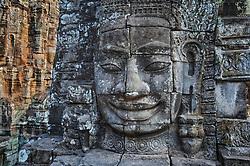 Single Buddha head at Bayon temple, late afternoon light