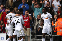 Swansea City's Tammy Abraham (right) celebrates scoring his side's first goal of the game during the Premier League match at the Liberty Stadium, Swansea.