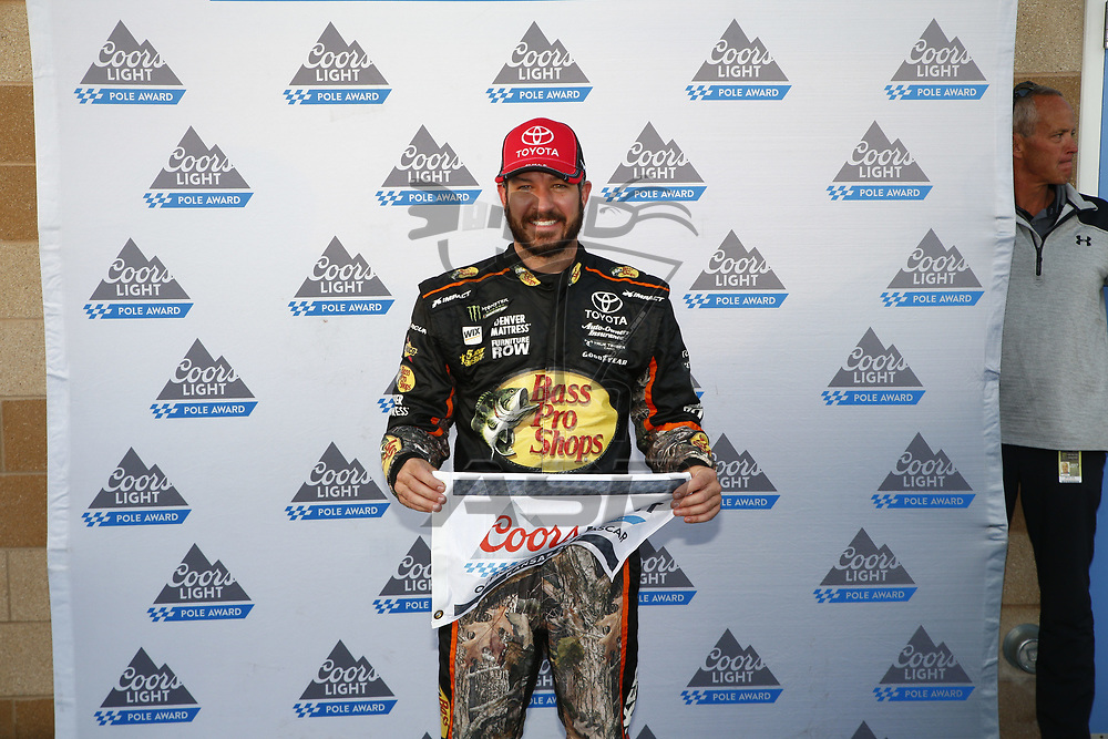 October 20, 2017 - Kansas City, Kansas, USA: Martin Truex Jr (78) wins the pole award for the Hollywood Casino 400 at Kansas Speedway in Kansas City, Kansas.