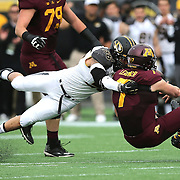 ORLANDO, FL - JANUARY 01: Mitch Leidner #7 of the Minnesota Golden Gophers gets tackled by Shane Ray #56 of the Missouri Tigers during the Buffalo Wild Wings Citrus Bowl at the Florida Citrus Bowl on January 1, 2015 in Orlando, Florida. (Photo by Alex Menendez/Getty Images) *** Local Caption *** Mitch Leidner; Shane Ray