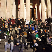 One the steps at night. The London Stock Exchange was attempted occypied in solidarity with Occupy Wall in Street in New York and in protest againts the economic climate, blamed by many on the banks. Police managed to keep people away fro the Patornoster Sqaure and the Stcok Exchange and thousands of protestors stayid in St. Paul's Square, outside St Paul's Cathedral. Many camped getting ready to spend the night in the square.