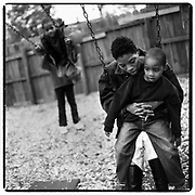 11/15/2002-Holiday Giving Guide. Turquandra McRae, 24, and her three children are staying at the Charlotte Emergency Housing. McRae's children are Damion Lynch (right), 4, Antonio Chattman Jr. (top left), 5, and Deconti Poe, 7. McRae is expecting another child in May. WENDY YANG/STAFF