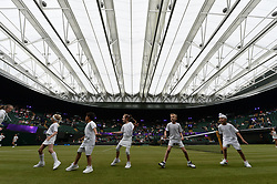 © Licensed to London News Pictures. 19/05/2019. London, UK. Wimbledon Junior Tennis Initiative players take part in the Wimbledon No. 1 Court Celebration event. The event marks the unveiling of a retractable roof and extended seating capacity at a cost of £70 million. Photo credit: Ray Tang/LNP
