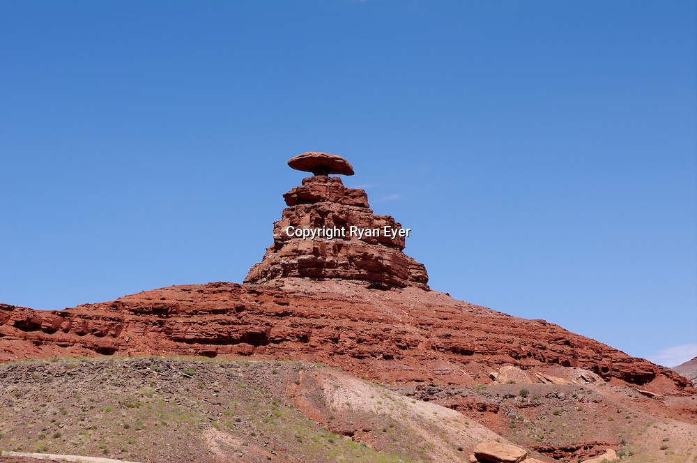 """MEXICAN HAT, UTAH - 9 July 2010 - Mexican Hat Rock is  sombrero-shaped, 60-foot (18 m) wide by 12-foot (3.7 m) thick (18.3 x 3.7 m), rock outcropping on the northeast edge of town of Mexican Hat. The """"Hat"""", which is near the famed Monument Valley, has two rock climbing routes ascending it..Picture: Ryan Eyer/Allied Picture Press"""