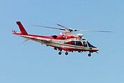 Fire fighter's helicopter AgustaWestland AW109 E Power Elite (VF-80) in flight at Malpensa (MXP / LIMC), Milan, Italy
