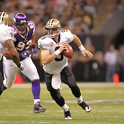 2008 October, 06: New Orleans Saints quarterback Drew Brees (9) scrambles away from Minnesota Vikings defensive tackle Kevin Williams (93) during the first half of a week five regular season game between the Minnesota Vikings and the New Orleans Saints for Monday Night Football at the Louisiana Superdome in New Orleans, LA.