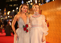 Margot Robbie (left) and Saoirse Ronan arrive at the European premiere of Mary Queen of Scots at Cineworld Leicester Square, London.