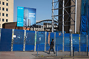 Blue hoarding around the construction site where a new high rise development, the Beorma Quarter, will be situated on nearly deserted streets near the iconic Selfridges building on 24th April 2020 in Birmingham, England, United Kingdom. Coronavirus or Covid-19 is a new respiratory illness that has not previously been seen in humans. While much or Europe has been placed into lockdown, the UK government has extended stringent rules as part of their long term strategy, and in particular social distancing.