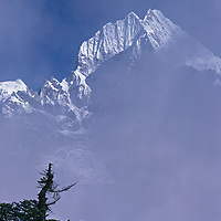 21,729 foot Mount Thamserku rises above fog in Khumbu Valley.