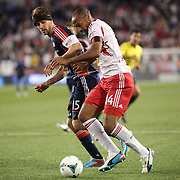 Thierry Henry, New York Red Bulls, challenged by Stephen McCarthy, New England Revolution during the New York Red Bulls V New England Revolution, Major League Soccer regular season match at Red Bull Arena, Harrison, New Jersey. USA. 20th April 2013. Photo Tim Clayton
