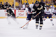 October 13, 2007 - Anchorage, Alaska: Ryan Cruthers (16) of the Robert Morris Colonials sends a shot past the defense by Mike Forgie (21) of the Wayne State Warriors in the Colonials 4-1 victory over the Wayne State Warriors at the Nye Frontier Classic at the Sullivan Arena.