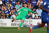 AFC Wimbledon goalkeeper Joe McDonnell (24) making clearance during the EFL Sky Bet League 1 match between AFC Wimbledon and Portsmouth at the Cherry Red Records Stadium, Kingston, England on 13 October 2018.