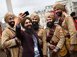 Jasdeep Singh (2nd left), Community Curator of the National Army Museum, takes a selfie with a group of volunteers dressed in WWI Sikh Regiment uniforms, during the Mayor of London Vaisakhi celebrations in Trafalgar Square, London, to mark the Sikh New Year.