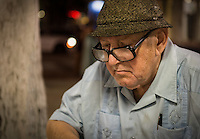 """MIAMI, FL - CIRCA JULY 2012: Cuban playing in the Domino Park in Little Havana circa July 2012 in Miami, during """"cultural fridays"""" an artistic, cultural, and social arts and culture fair that takes place on the last Friday of each month in the historic Little Havana."""