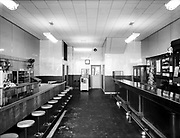 "Ackroyd 00011-79  ""Beaver. Pre-decoration. 1947"" Beaver Restaurant, 2384 NW Thurman. Decoration was completed by August, 1947. Note slot machine in rear."