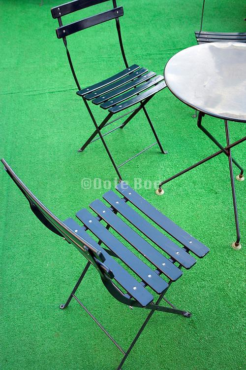 garden chairs on fake green grass carpet