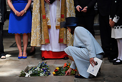 Jane Hawking lays flowers as the ashes of Professor Stephen Hawking, are laid to rest during his memorial service at Westminster Abbey, London.