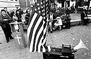 Missionary preaching the word of God with American flag