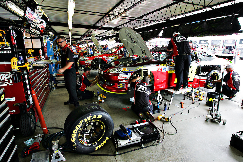May 12, 2012; Darlington, SC, USA; The crew of NASCAR Sprint Cup driver Jeff Gordon (24) works on their car in the garage before the Southern 500 at Darlington Raceway. Mandatory Credit: Peter Casey-US PRESSWIRE.
