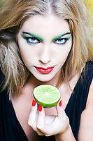 beautiful woman portrait with colorful make-up  and background holding citrus