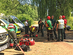 Members of the West Midlands Ambulance Service's HART (Hazardous Area Response Team) gear up with dry-suits, to help with a joint agency emergency services' search for missing boy, 13-year-old Ryan Evans, at Westport Lake, Stoke-on-Trent.
