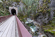 A Bridge over the Coquihalla River and one of the Othello Tunnels in Coquihalla Canyon Provincial Park near Hope, British Columbia, Canada.  These paths and tunnels were part of the Kettle Valley Railway which ran from Hope to Midway in British Columbia. The tunnels and railway were constructed in 1914 and are also known as the Quintette tunnels.