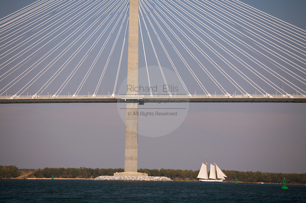 Tall ship Spirit of South Carolina passes under the Arthur Ravenel Bridge in Charleston harbor South Carolina.