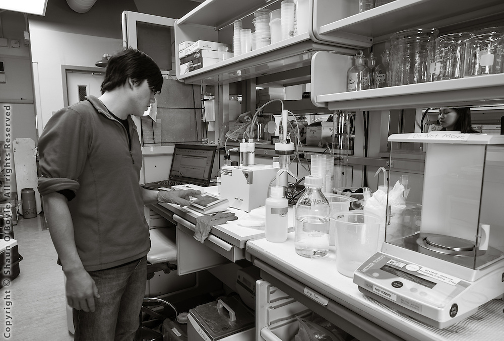 Lab technician Cailan Sugano working in Crary Lab testing water samples