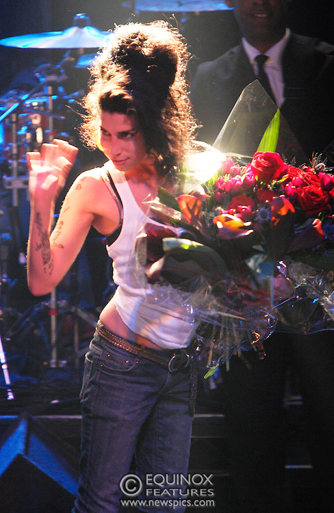 Singer Amy Winehouse, DOB=14/09/1983, performing for her gay fans at the G-A-Y Club. G-A-Y is London's biggest gay club and is held at the London Astoria nightclub, Soho, London, UK. Amy spent much of the show rubbing her itchy nose. She also seemed to have signs of old scars all down one arm...Picture Data:.Photographer: Edward Hirst.Copyright: ©2007 Licensed to Equinox News Pictures +448700 780000.Contact: Equinox Features.Date Taken: 20070415.Time Taken: 020532+0000.www.newspics.com