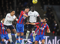 Football - 2019 / 2020 Premier League - Crystal Palace vs. Liverpool<br /> <br /> Sadio Mane of Liverpool out jumps Gary Cahill and James McArthur, at Selhurst Park.<br /> <br /> COLORSPORT/ANDREW COWIE