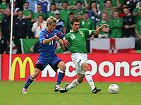Photo: Andrew Unwin.<br />Northern Ireland v Iceland. European Championships 2008 Qualifying. 02/09/2006.<br />Iceland's Gunnar Heldar Thorvaldsson (L) looks to tackle Northern Ireland's Aaron Hughes (R).