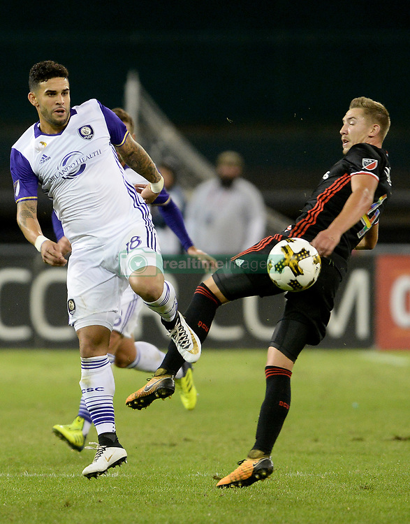 September 9, 2017 - Washington, DC, USA - 20170909 - Orlando City FC forward DOM DWYER (18) and D.C. United midfielder RUSSELL CANOUSE (4) bounce off one another while trying to play the ball in the second half at RFK Stadium in Washington. (Credit Image: © Chuck Myers via ZUMA Wire)