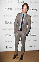 LONDON - OCTOBER 31: Eddie Redmayne attended the Harper's Bazaar Women of the Year Awards at Claridge's Hotel, London, UK. October 31, 2012. (Photo by Richard Goldschmidt)