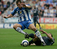 Photo: Dave Howarth.<br />Wigan Athletic v Bolton Wanderers. The Barclays Premiership. 02/10/2005. Lee McCullock under preasure