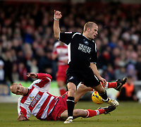 Photo: Jed Wee.<br />Doncaster Rovers v Swansea City. Coca Cola League 1.<br />17/12/2005.<br />Swansea's Andy Robinson (R) is tackled by Doncaster's Steve Roberts.