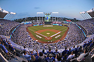 Sep 30, 2014; Kansas City, MO, USA; A sell out crowd stands during the playing of the National Anthem prior to the start of the 2014 American League Wild Card playoff baseball game between the Kansas City Royals and the Oakland Athletics at Kauffman Stadium. Mandatory Credit: Peter G. Aiken-USA TODAY Sports