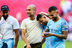 Manchester City manager Pep Guardiola congratulates Sergio Aguero after he scores both goals as  they win the Community Shield with a 2-0 victory over Chelsea - Rogan/JMP - 05/08/2018 - FOOTBALL - Wembley Stadium - London, England - Chelsea v Manchester City - The FA Community Shield.