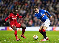Football - 2019 / 2020 UEFA Europa League - Round of Sixteen, First Leg: Rangers vs. Bayer 04 Leverkusen<br /> <br /> Borna Barisic of Rangers vies with Moussa Diaby of Bayer Leverkusen, at Ibrox Stadium, Glasgow.<br /> <br /> COLORSPORT/BRUCE WHITE
