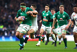 Ireland's CJ Stander (left) scores his side's second try during the NatWest 6 Nations match at Twickenham Stadium, London.