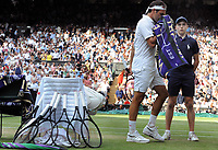 Tennis - 2019 Wimbledon Championships - Week Two, Sunday (Day Thirteen)<br /> <br /> Men's Singles, Final: Novak Djokovic (SRB) vs. Roger Federer (SUI)<br /> <br /> Federer at the change over with his used tennis rackets, on Centre Court.<br /> <br /> COLORSPORT/ANDREW COWIE