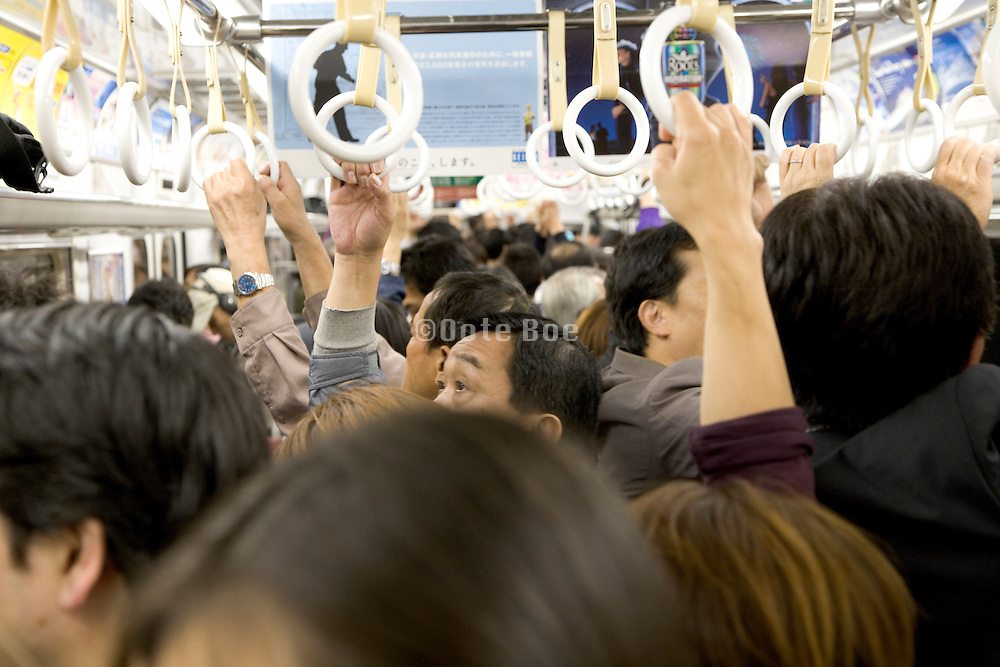 commuter train at rush hour full with businesspeople in Tokyo Japan