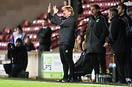 Scunthorpe United manager Stuart McCall gestures towards Referee Andy Haines about the amount of extra time during the The FA Cup 1st round match between Scunthorpe United and Burton Albion at Glanford Park, Scunthorpe, England on 10 November 2018.